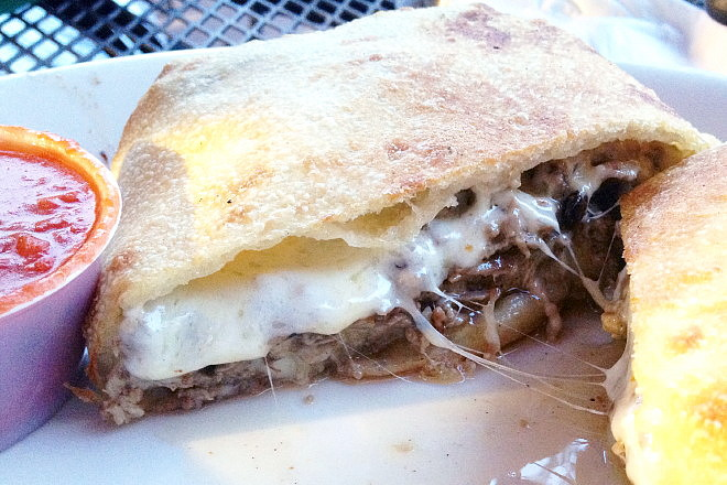 photo of steak and cheese calzone from Doyle's Pub and Grill, Brockton, MA