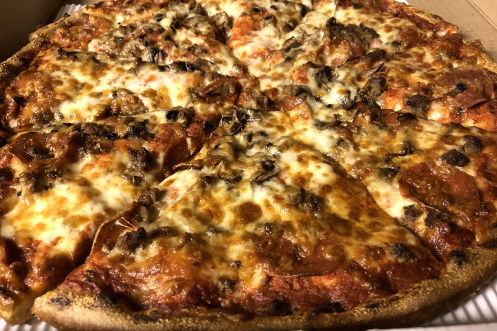 photo of pepperoni, mushroom, and hamburger pizza from New London Pizza, Concord, MA