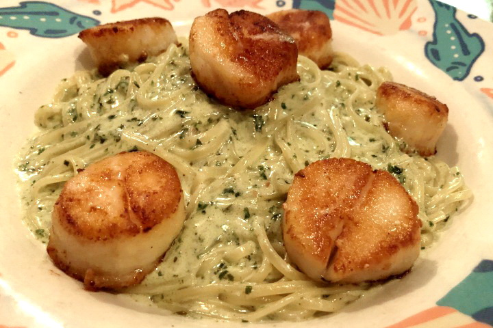 photo of pan-roasted sea scallops with pesto cream sauce from Out of the Blue, Somerville, MA
